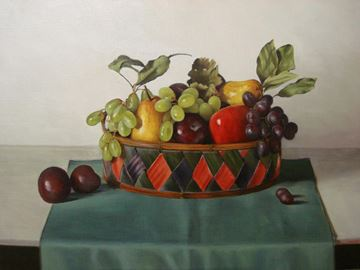 Basket of Seasonal Fruit on a Green Cloth