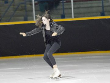 The Stayner Figure Skating Club held its annual carnival at the Stayner Arena on Saturday night. This year's theme was Saturday Magic. As a result, routines reflected different Saturday activities. This routine is based on going to see a movie on Saturday night. Ceilidh McInnis skates as Sandy from the movie Grease.