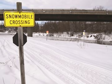 Snowmobilers face charges