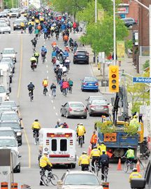 Off in the dsitance Hundreds of cyclists tooking part in the Bells on Bloor ride on Saturday leading off along Bloor Street from High Park to downtown Toronto. May 11