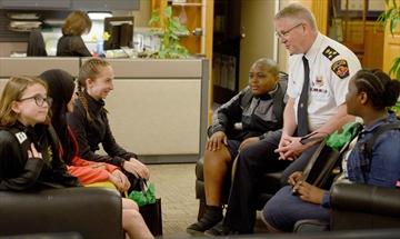 Hamilton Police Chief Eric Girt, second from right, speaks with five Grade 6 students who won the opportunity to be Police Chief for a Day through an essay-writing competition. The students were greeted by the chief before being given a tour of Central Station. They were taken to Ancaster to meet the city's mounted police before wrapping up their day at the Mountain Station. From left to right, the lucky students include Angeline Smeets, Zainab Syed, Isabella Ramalli, Justice Umelo and Cedrina Morris.  Correction: This caption was edited May 16 to correct Chief Eric Girt's name, which was misspelled.