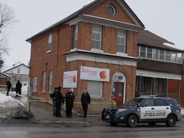 There was a heavy police presence in downtown Bradford this afternoon as York Regional and South Simcoe police officers joined forces to arrest a suspect in relation to a double stabbing in Newmarket Feb. 12.