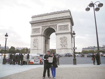 Clayton and Katy Letourneau stand in front of Arc de Triomphe in Paris, France.