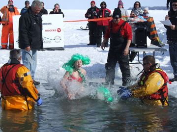 Dozens of men, women and youngsters worked up their courage to raise funds for good causes by plunging into the frigid waters of Cook's Bay.