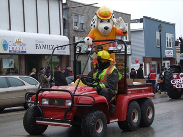 Sparky The Fire Safety Dog gives a wave during the parade.