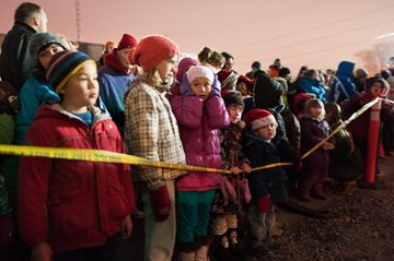 Children wait at the front of the line for the CP Holiday Train to pull into Lambton Yard on Saturday. The evening included food and cash donations and entertainment on the boxcar. The train is raising awareness about hunger issues in Canada while visiting over 150 communities. (Dec. 1, 2012)