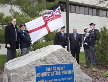 (Left to right) Royal Canadian Naval Association Niagara member Mike Britton, Robert Coles, president Charles Johnston, Niagara Region chair Jim Bradley, master of arms George Williams and vice-president Harvey Villard perform a flag raising ceremony to declare April 29 to May 5 Navy Week in Niagara.