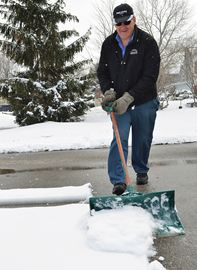 Len Vivian grabbed his shovel and made quick work of the snow on his driveway at his home on Fox Street in Penetanguishene.