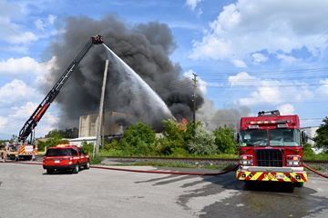 Emergency crews are battling a fire near Dixie Road and The Queensway.