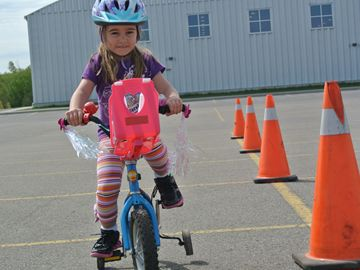 Julia Black, 5, Caledon East, rides her bike on the OPP Bike Roadeo course.