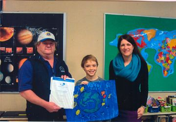 On March 31, Nobel Public School student Graeme Bishop, photo and McDougall Public School student Kennedy Munro, were the winners of the Lions Club's International Peace Poster contest. The winners received a certificate of achievement and $25 cash. Graeme is pictured with Lions Club president Keith Gardner, and his teacher, Amanda Vankoughnett. Kennedy is pictured with Gardner, and her teacher Robert Hammond.
