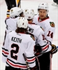 Blackhawks overwhelm short-handed Penguins 5-1-Image1