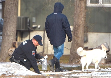 A forensics officer collects evidence along Beach Boulevard Sunday. Hamilton police were called to the east Hamilton residence Saturday. A 33-year-old Hamilton man is facing an aggravated assault charge after another man suffered serious face injuries on Beach Boulevard Friday night.