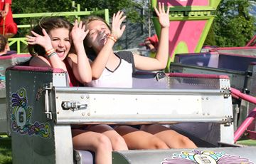 Brianna Bertrin and Melanie Clement enjoy a ride on the Scrambler, one of a dozen rides on the Odessa Fair Midway.