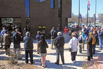 A crowd gathers for a National Day of Mourning vigil outside of Niagara Falls City Hall. Niagara District CUPE Council is promoting a series of vigils for this year's Day of Mourning on Saturday, Apr. 28.