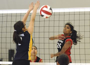 Parkdale Collegiate's Stephanie Vasanthakumar spikes the ball past C. W. Jefferys' Jennifer Huynh during the TDSB girls volleyball 1A final Friday. Parkdale defeated C. W. Jeffreys Collegiate 25-19, 25-22, 25-22 at Centennial College.
