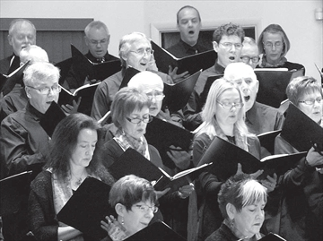 Members of the Arnprior Community Choir are in fine voice as they present their annual Christmas concert to a sold-out house at Glad Tidings Pentecostal Church Sunday. The choir was directed by Lisa Webber with piano accompaniment by Andrea de Boer. The Sing Noel concert also included songs by the Ottawa Valley Girls Choir.
