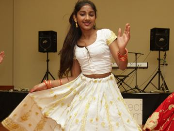 Karishma Singh entertains guests at the second annual Autism Awareness Variety Show at OE Banquet & Conference Centre.