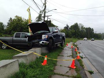 Truck v. concrete barrier