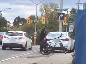 Two Halton police officers nail 13 distracted drivers in Oakville in just five hours