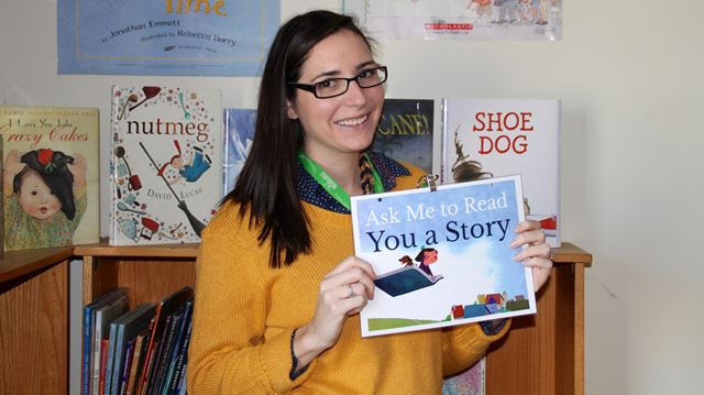 Brianne Peters, Children's Librarian at KFPL, invites kids to ask staff to read to them during literacy week at the library.