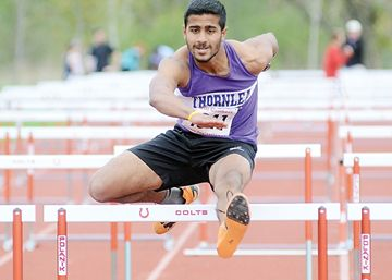 Ammar Jessa of Thornlea Secondary School wins the senior boys hurdles at the Bill Crothers invitational high school track meet May 8.