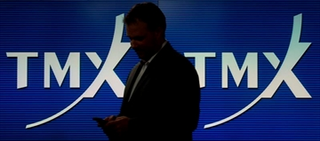 A man works in the TMX broadcast centre in Toronto, May 9, 2014. THE CANADIAN PRESS/Darren Calabrese