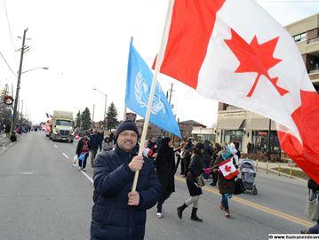 Santa parade refugees