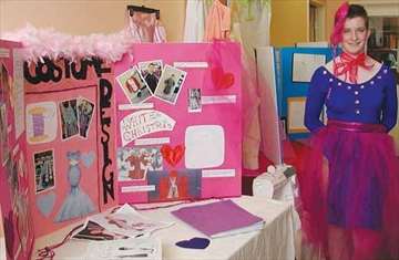 Taite Krueger wears the costume which she designed and made for her grade eight project presentation at the Ottawa Waldorf School in Stittsville on Wednesday, Feb. 26 as she stands beside her display explaining her project.