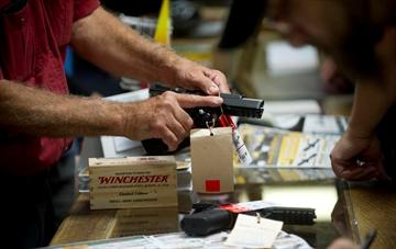 Annual gun sale comes amid gun control debate
