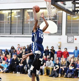 Garneau high school's Khadeem Pierre finds the net during the tier one city championship final game held on Feb. 26 at Garneau. Garneau beat Bell 68-53.