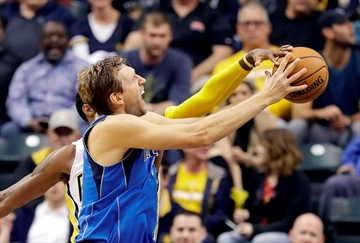Nowitzki will miss Mavs' home opener with stomach illness-Image1