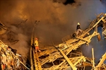 Rescuers searching for victims of Iran building collapse-Image5