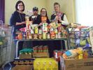 Apartment building pitches in for food drive