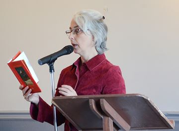 Seniors were welcome to this event that offered music, readings, and refreshments. Here Catherine Sword of the host Whitchurch-Stouffville Public Library conducts a reading.