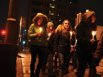 OSHAWA -- The World AIDS Day candlelight walk, hosted by the AIDS Committee of Durham Region, took place in the downtown. December 1, 2013