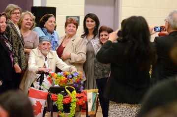 Guests clamour to be in a photograph with Uncle Norooz, played by 95-year-old Mohammad Novin during an Iranian New Year's celebration at Richmond Hill's Langstaff Community Centre March 15. Norooz celebrations date back 3,000 to Persia and marks the transition from winter to spring.