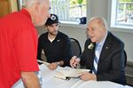 Hockey legend Red Kelly greets fans in Penetanguishene