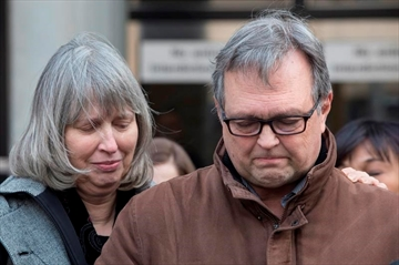 Clayton Babcock, right, stands next to his wife Linda as he reads a prepared statement outside court in Toronto on Saturday, December 16, 2017. Two men accused of killing a young Toronto woman and burning her body have been found guilty of first-degree murder. Dellen Millard and Mark Smich had pleaded not guilty to the charges related to the death of 23-year-old Laura Babcock, whose body has not been found. THE CANADIAN PRESS/Chris Young