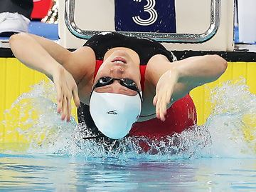 Trying summer can't prevent Burlington's Russell from earning first international medal