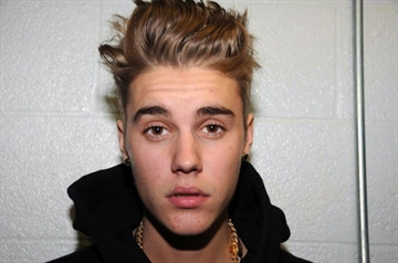 Bieber charged with assault in ATV crash-Image1