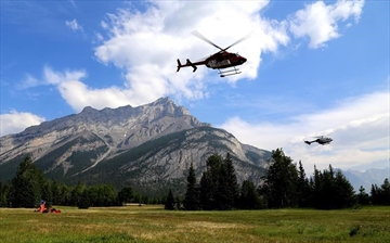 Helicopters are seen leaving a fire base for the Verdant Creek wildfire in an undated Parks Canada handout image. The Verdant Creek wildfire has spread over about 25 to 30 square kilometres in Kootenay National Park and Mount Assiniboine Provincial Park in British Columbia on the Alberta boundary. THE CANADIAN PRESS/HO-Parks Canada, *MANDATORY CREDIT*