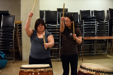 Instructor Mandy Fung shows a student proper technique.