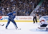 Sedin gets 1,000th point in Canucks' win-Image1