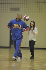 The Harlem Globetrotters' Herbert 'Flight Time' Lang passes the ball to Earl Haig Secondary School Grade 9 student Nuri Lee during a visit to the school Monday by the world renowned basketball team in support of Earl Haig's 30 Hour Famine. (Apr. 7