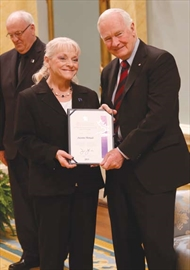 Suzanne Thériault from Orléans receives the Caring Canadian Award from Gov.-Gen. David Johnston on April 17.