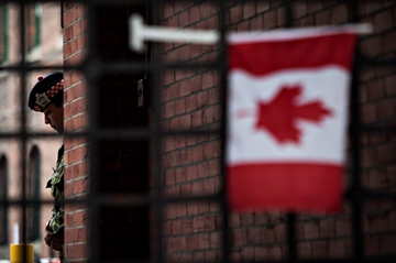 Man detained nearby as Harper visits memorial-Image1