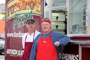 Scott Dean (left) and Mike Ford are the owners of Fordino's mobile pizzeria in Kingston. The duo served up fresh pizza for patrons of Martha's Table on Nov. 24.
