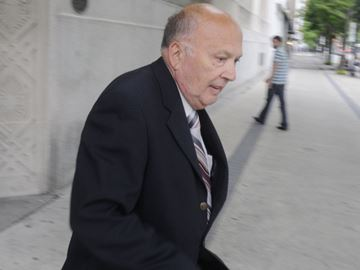 Donald Grecco, a former priest from the Diocese of St. Catharines, runs from the Hamilton courthouse earlier this year.