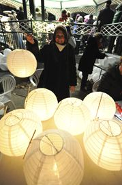 Lorraine Daigle displays lanterns for sale during Earth Hour events at Kew Gardens March 29.